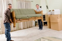 two men carrying sofa