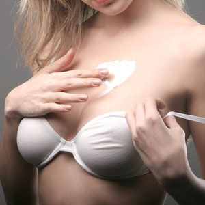 Applying Breast Enhancement Cream