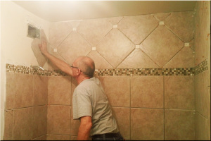 Old man cleaning Bathroom