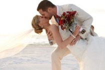 Newly Wed kissing on beach