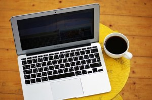 Laptop and coffee in mug